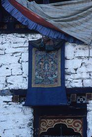 Dance of the Raksha (Raksha mang 'cham): thang ka of Avalokiteshvara hanging above the head of Yama Dharmaraja  gshin rje chos rgyal), Paro Tshechu (tshe bcu), 4th day (Paro, Bhutan)